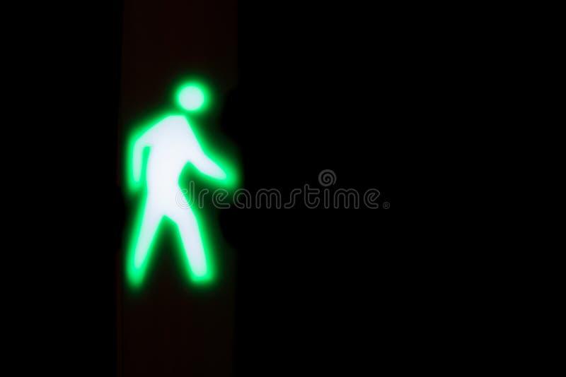 Het gloeien licht wat om signaleren te lopen of te kruisen royalty-vrije stock foto's