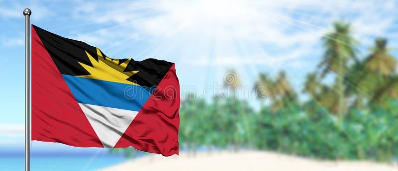 Het golven Antigua en de vlag van Barbuda in de zonnige blauwe hemel met de achtergrond van het de zomerstrand r royalty-vrije stock afbeeldingen