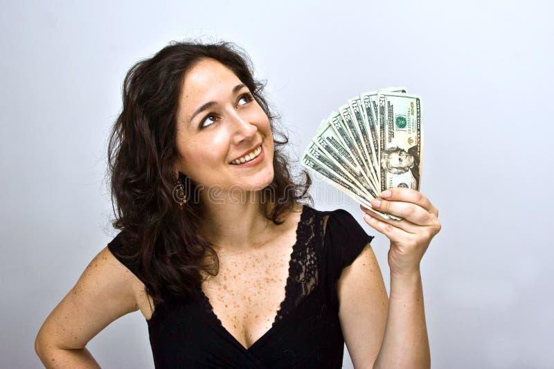Het golvende geld van de vrouw royalty-vrije stock afbeelding
