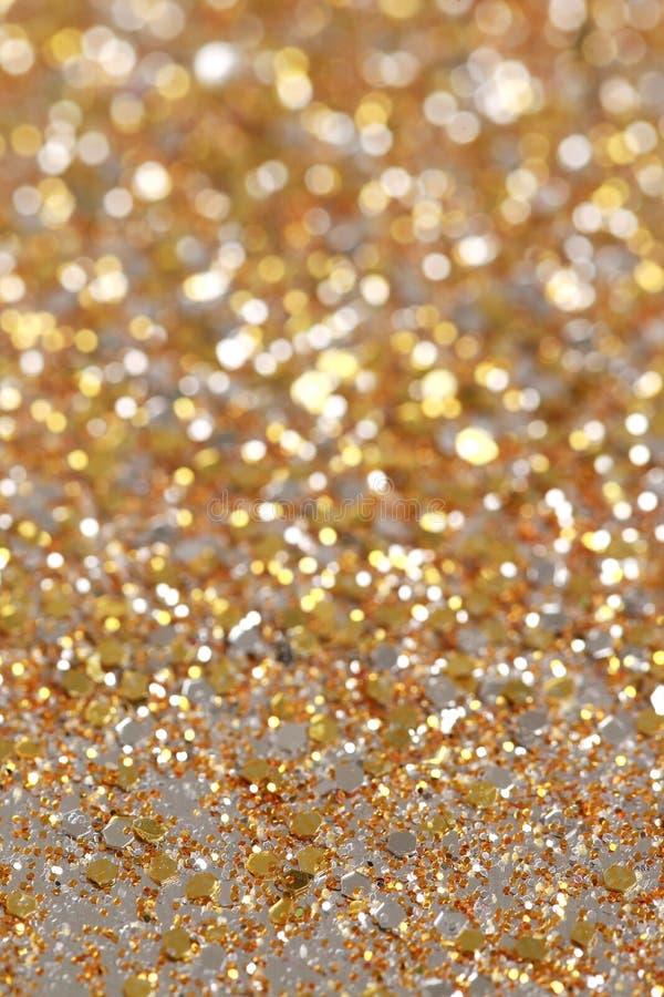 Het Goud en het Zilver van het Kerstmisnieuwjaar schitteren achtergrond Vakantie abstracte textuur stock foto