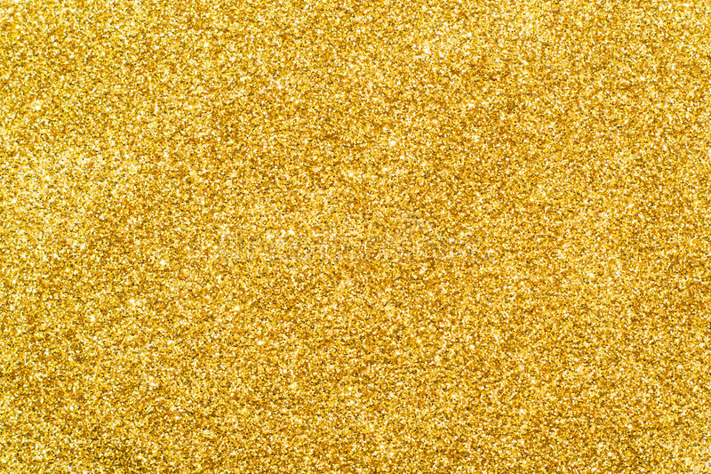 Het goud schittert fonkelend lovertje als achtergrond stock foto's