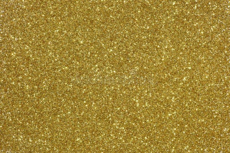 Het goud schittert textuur abstracte achtergrond stock fotografie