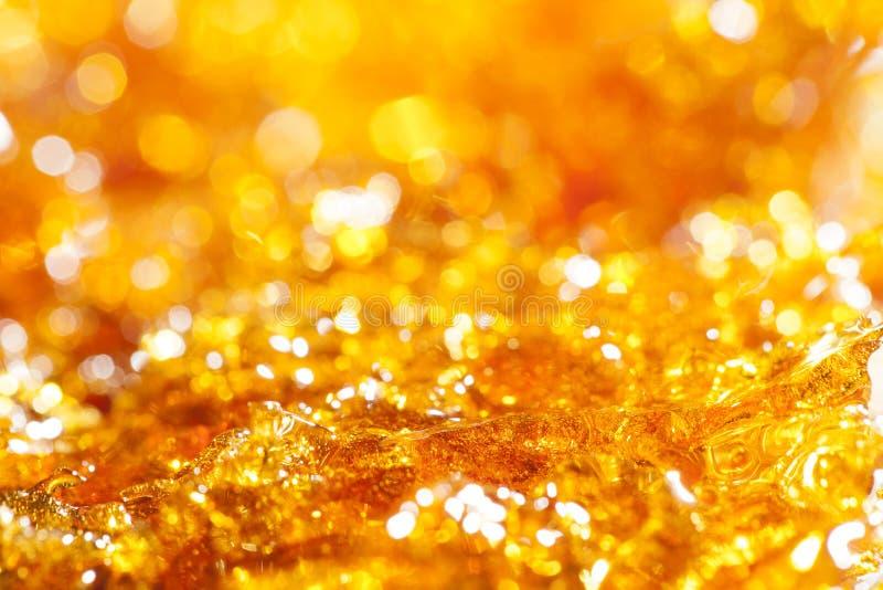 Het goud van de karamel schittert stock fotografie