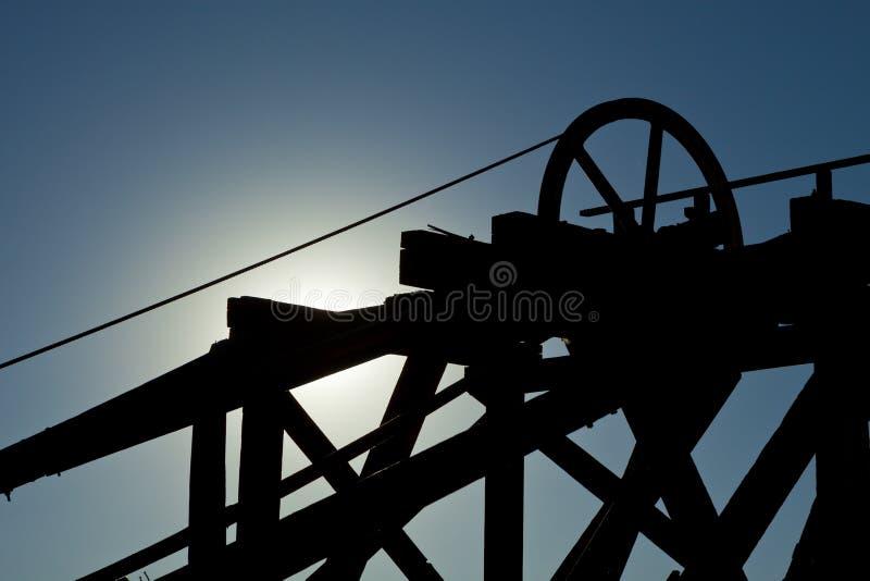 Het gouden Hijstoestel van de Mijn van de Heuvel stock foto's