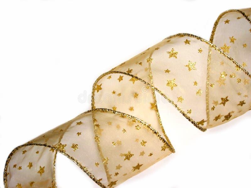 Het gouden lint van Kerstmis royalty-vrije stock afbeelding