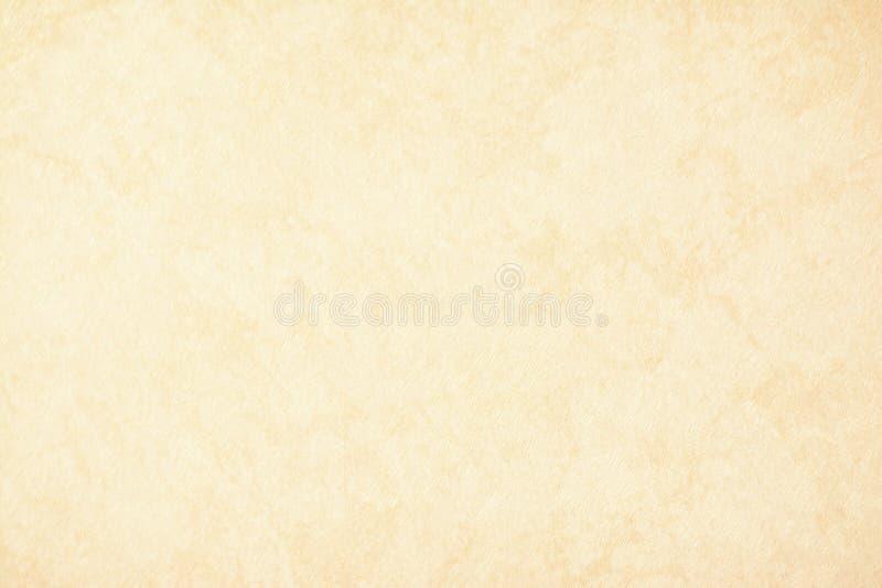 Het gouden textuurdocument als achtergrond in gele uitstekende room of het beige kleurt, perkamentdocument, abstracte pastelkleur stock foto's
