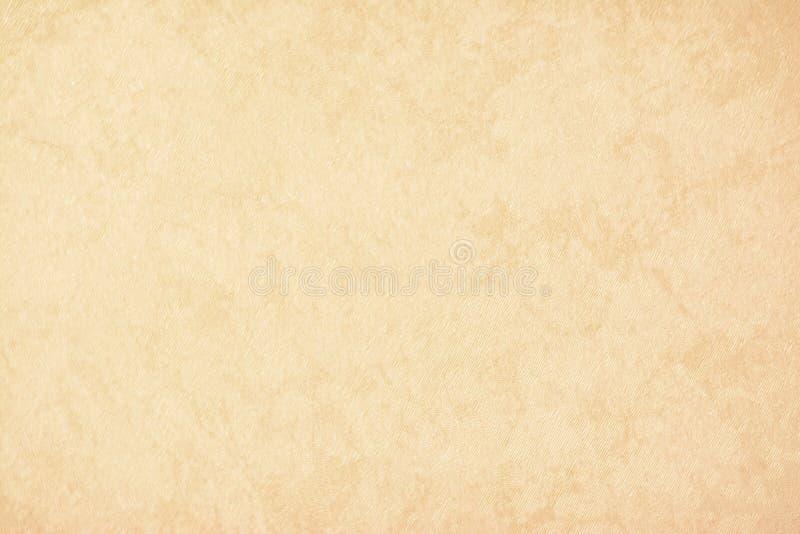 Het gouden textuurdocument als achtergrond in gele uitstekende room of het beige kleurt, perkamentdocument, abstracte pastelkleur stock fotografie