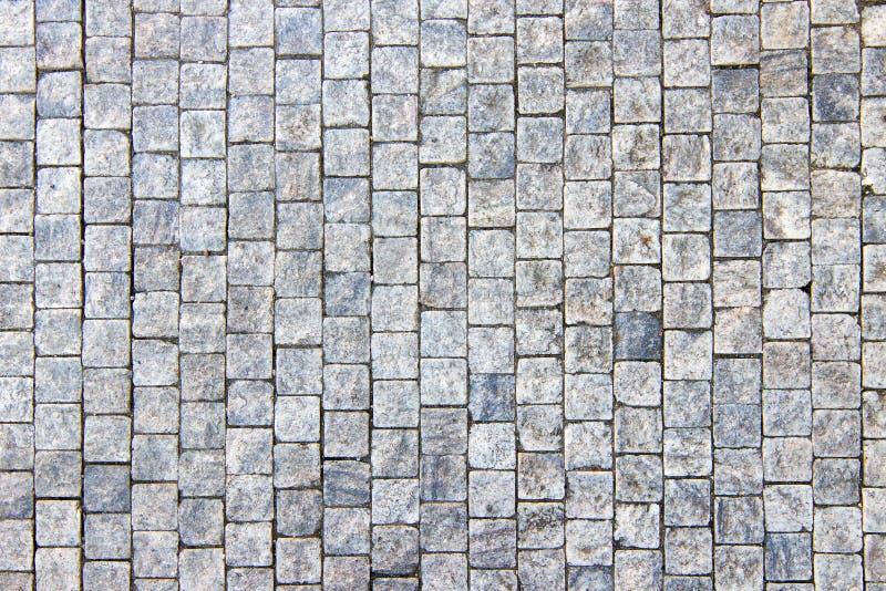 Het graniet cobblestoned bestratingsachtergrond royalty-vrije stock afbeelding