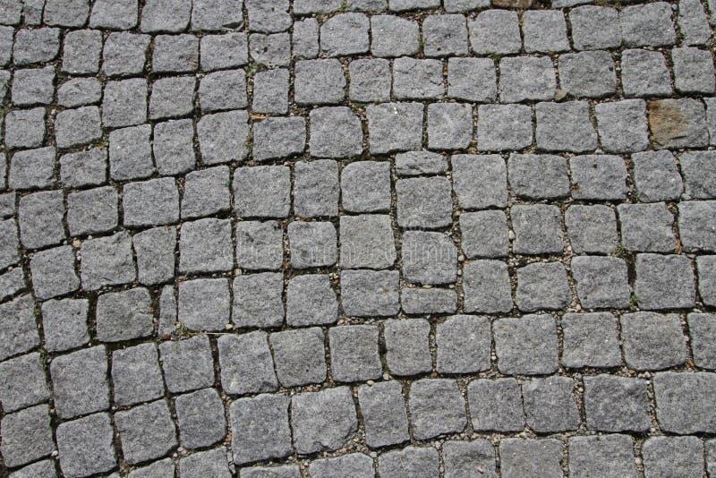 Het graniet cobblestoned bestratingsachtergrond stock afbeelding