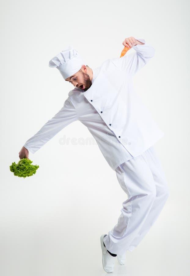 Het grappige chef-kokkok dansen royalty-vrije stock foto