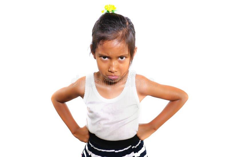 Het grappige portret van snoepje verstoorde en stelde 7 jaar teleur het oude Aziatische meisje kijken intens aan de camera voelen stock afbeeldingen