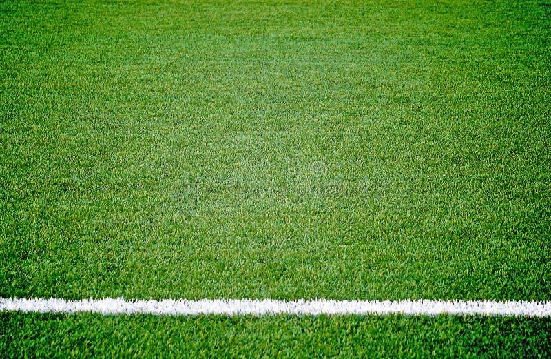 Het grasgebied van de voetbalvoetbal royalty-vrije stock foto's