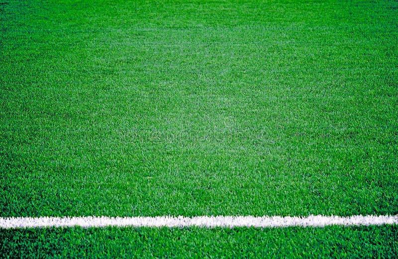 Het grasgebied van de voetbalvoetbal royalty-vrije stock afbeeldingen