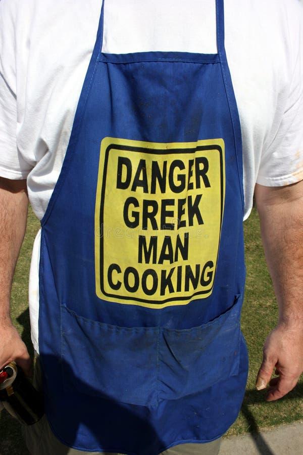 Het Griekse mens koken royalty-vrije stock afbeelding