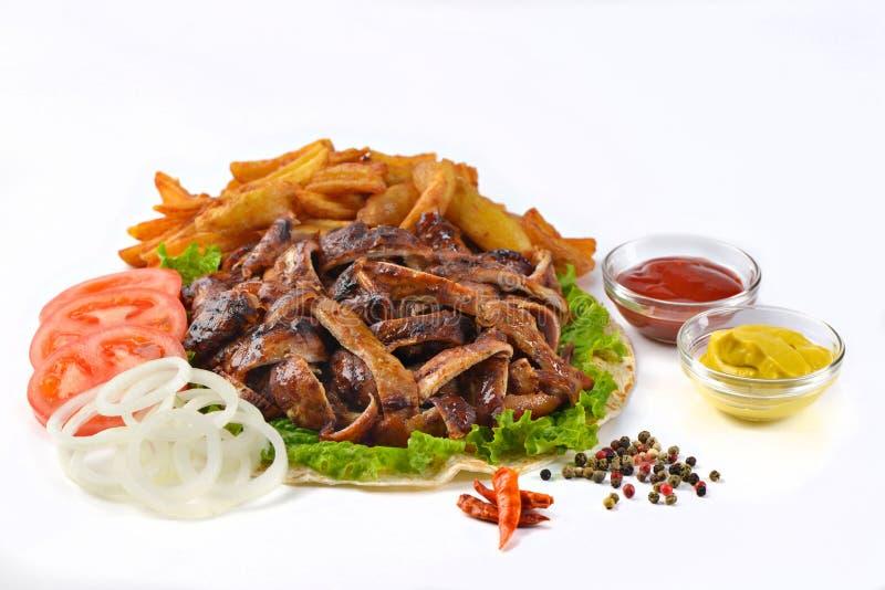 Het Griekse vlees van het de ongezonde kostvarkensvlees van de gyroscopensandwich royalty-vrije stock foto's