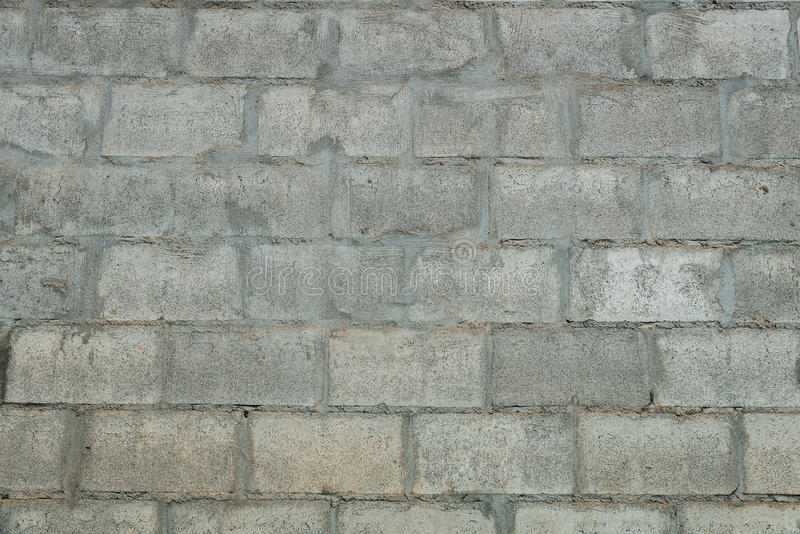 Het grijze beton blokkeert muur, naadloze achtergrondfototextuur stock foto's