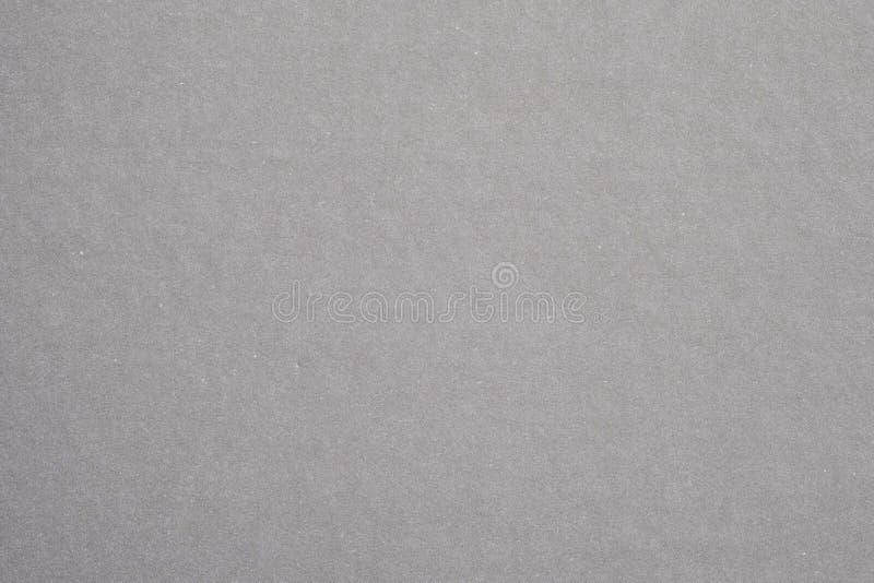 Het grijze document van textuurkraftpapier stock afbeeldingen