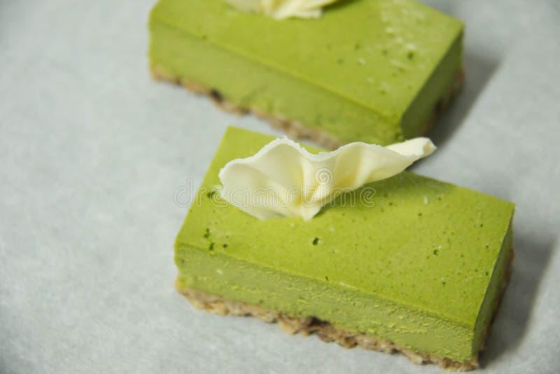 Het groene dessert van de theekaastaart stock afbeeldingen