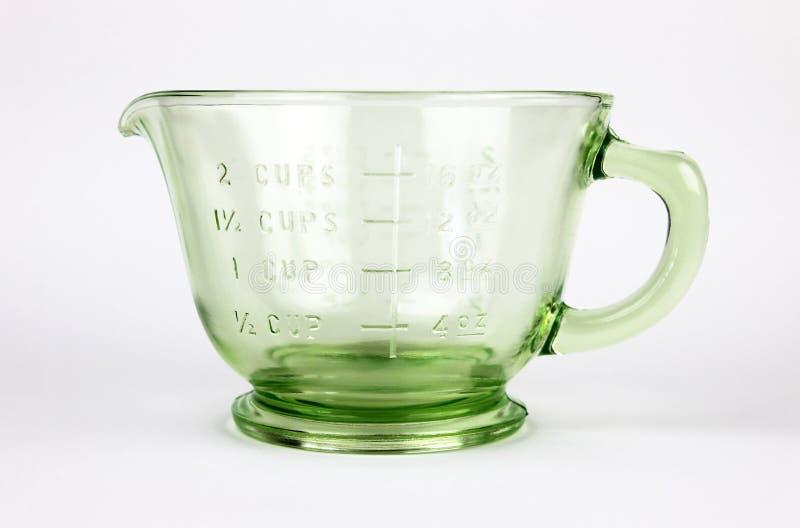 Het groene Glas dat van de Depressie Kop meet royalty-vrije stock afbeeldingen
