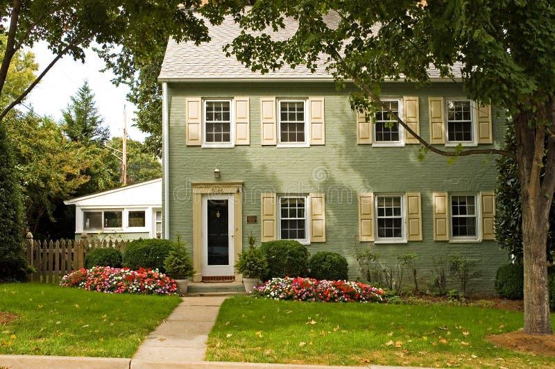 Het groene Huis van de Baksteen stock foto