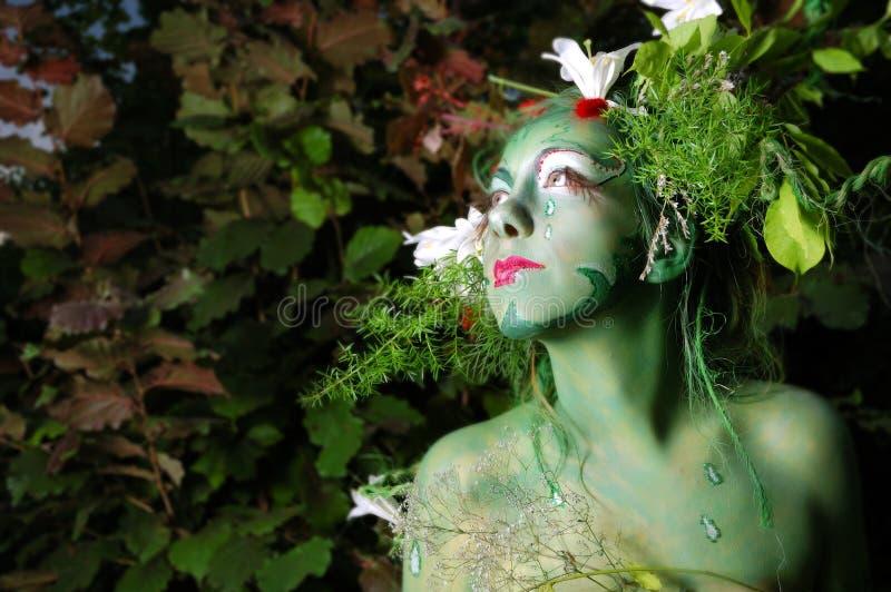 Het groene milieugezicht schilderen stock fotografie