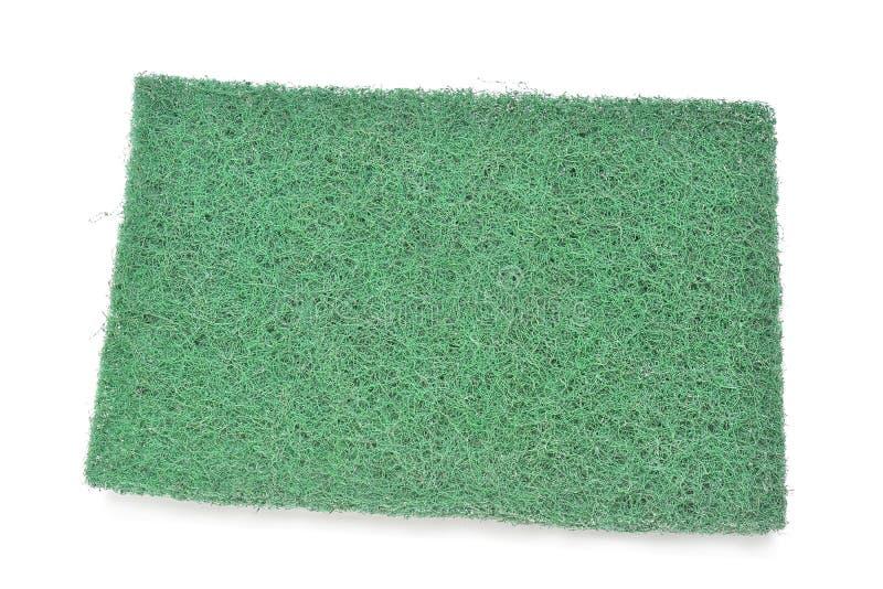 Het groene stootkussen van het vezelschuursponsje op witte achtergrond royalty-vrije stock foto