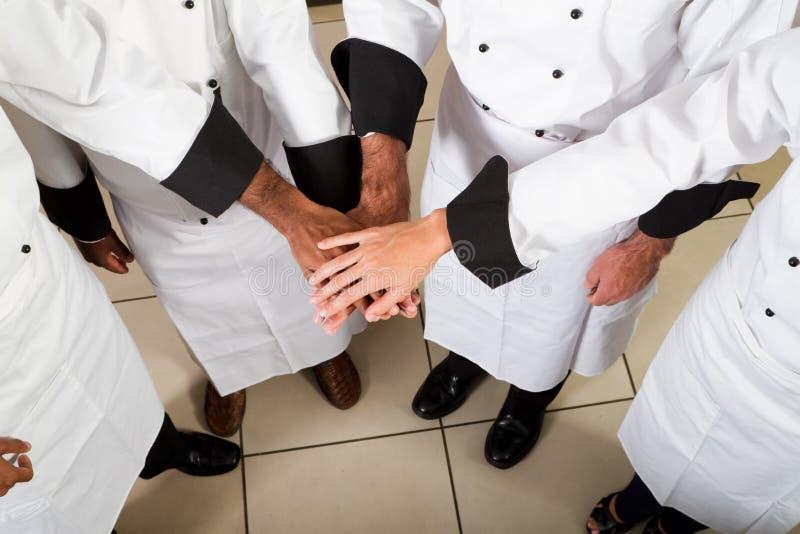 Het groepswerk van de chef-kok royalty-vrije stock afbeelding
