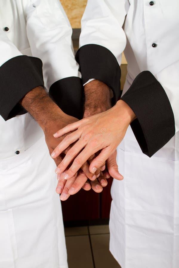 Het groepswerk van de chef-kok stock foto's