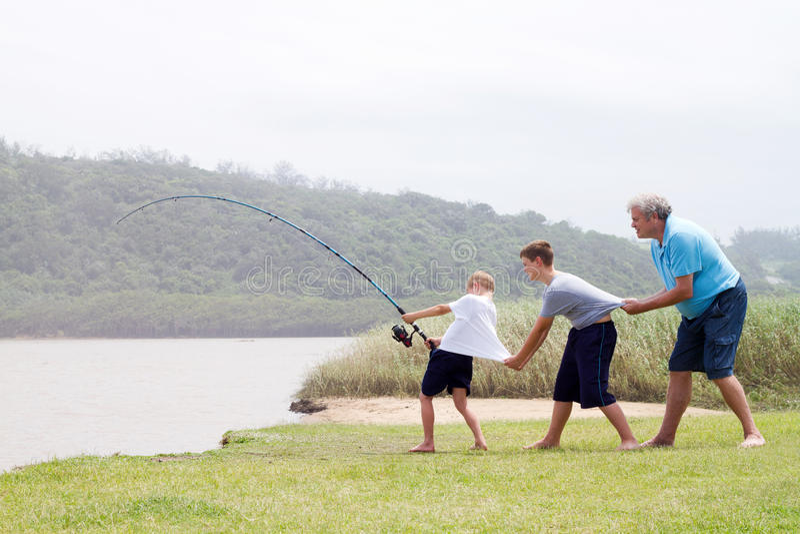 Het groepswerk van de visserij stock foto