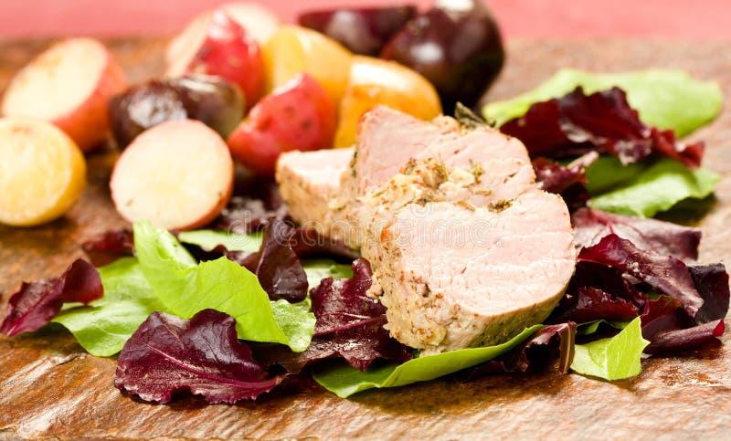 Het Haasbiefstuk van het Varkensvlees van Encrusted van het kruid royalty-vrije stock afbeeldingen