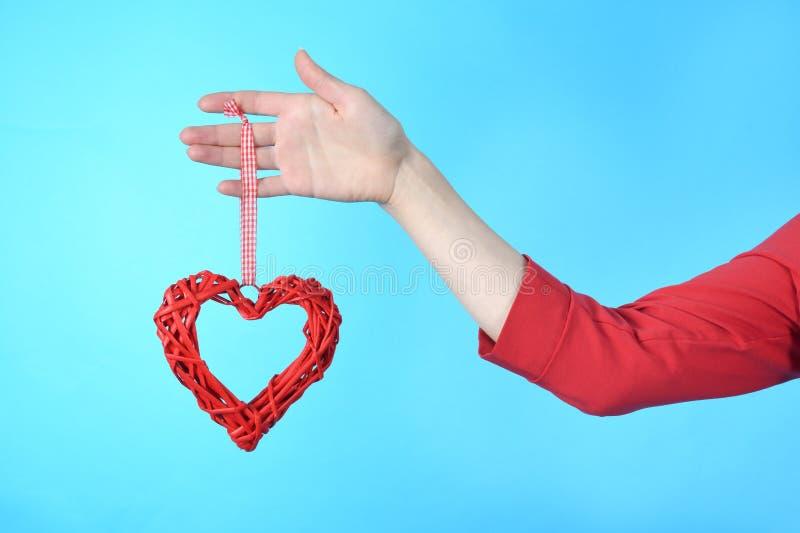 Het hart van het de holdingssymbool van de vrouwenhand ter beschikking royalty-vrije stock afbeelding