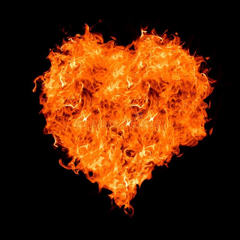 Het hart van de vlam op zwarte stock foto