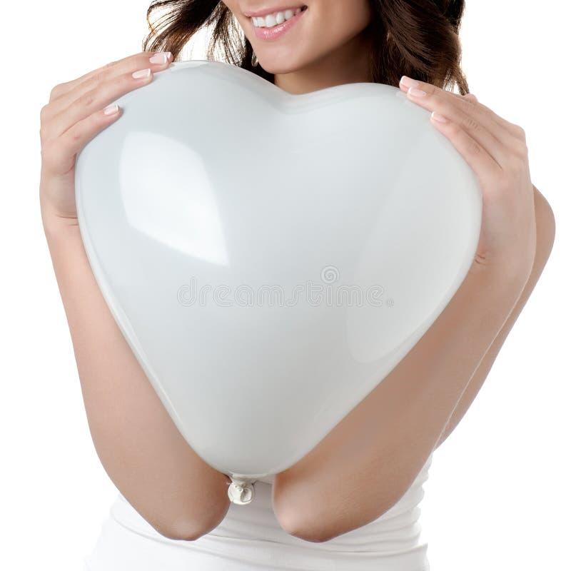 Het hart van de vrouwenholding royalty-vrije stock afbeelding
