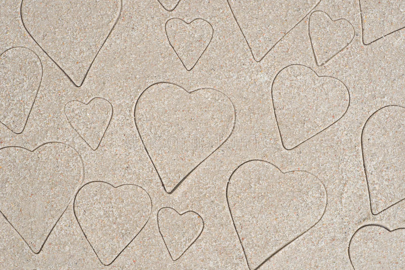 Het hart vormt patroontekening in zand royalty-vrije stock afbeelding