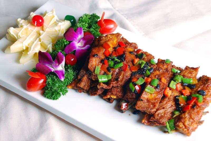 Het heerlijke voedsel van China--gebraden varkensvleesribben stock afbeelding