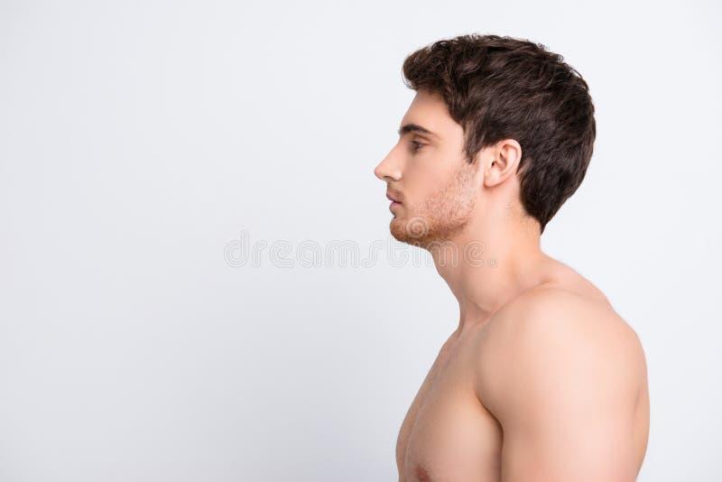Het helft-onder ogen gezien portret van het profiel zijaanzicht van zeker sexy sportief m stock afbeeldingen