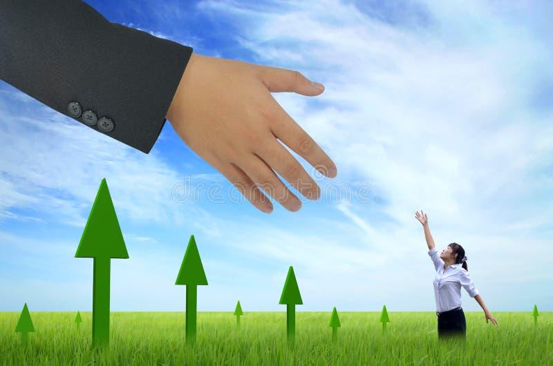 Het helpen van hand voor zaken stock fotografie