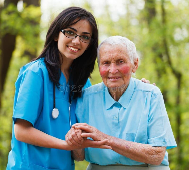 Het helpen van Verpleegster stock fotografie