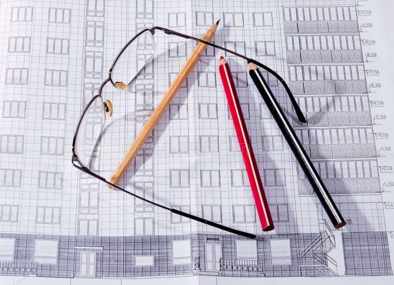 Het het de de bouwplan, glazen en potlood royalty-vrije stock afbeeldingen