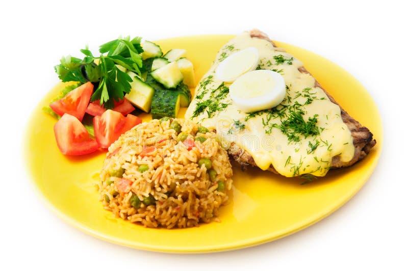 Het het varkensvleeslapje vlees van het restaurant Mexicaanse menu met ei en rijst stock afbeelding