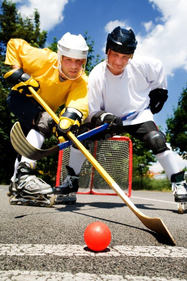 Het hockeystrijd van de straat royalty-vrije stock fotografie