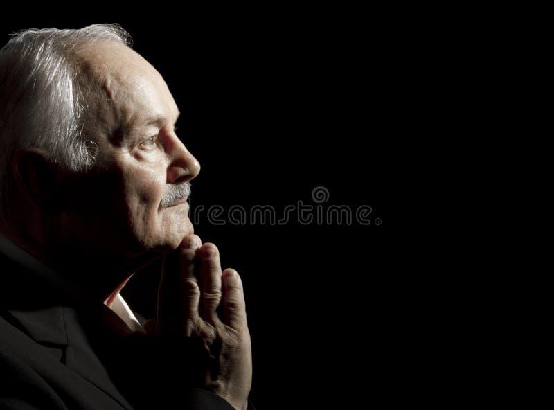 Het hogere mens bidden stock foto's
