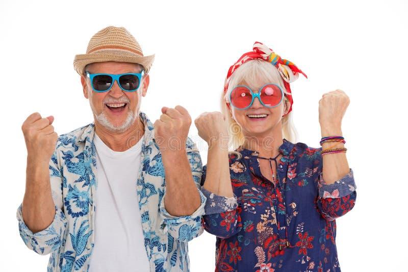 Het hogere paar kleedde zich als een hippie stock afbeelding