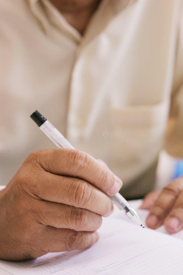 Het hogere schrijven stock afbeeldingen