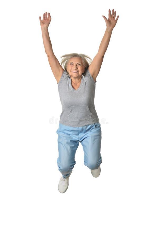 Het hogere vrouw springen stock afbeelding