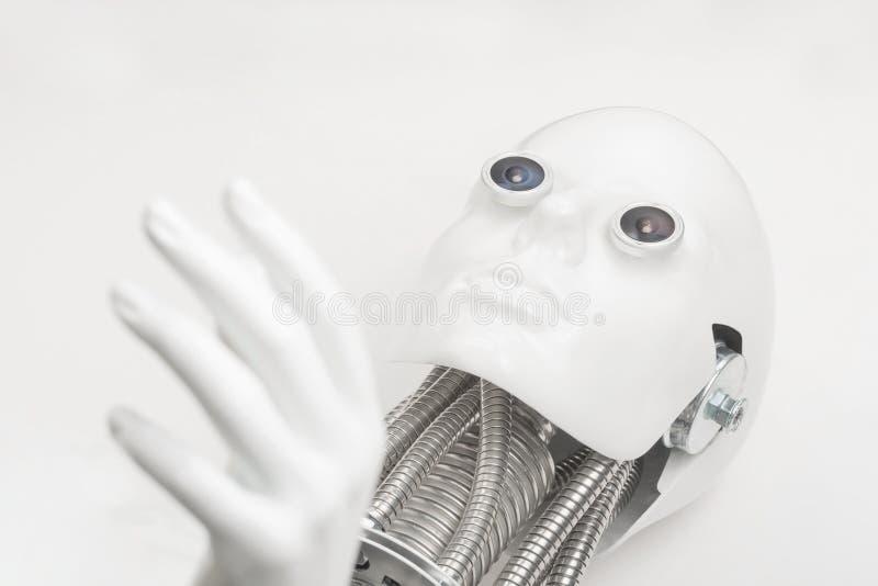 Het hoofd van de Humanoidrobot met handclose-up stock afbeeldingen