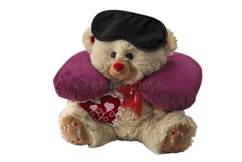 Het hoofdkussen voor hals en het masker voor oog worden gezet op een stuk speelgoed dragen Slaaptoebehoren voor het reizen Geïsol royalty-vrije stock afbeelding