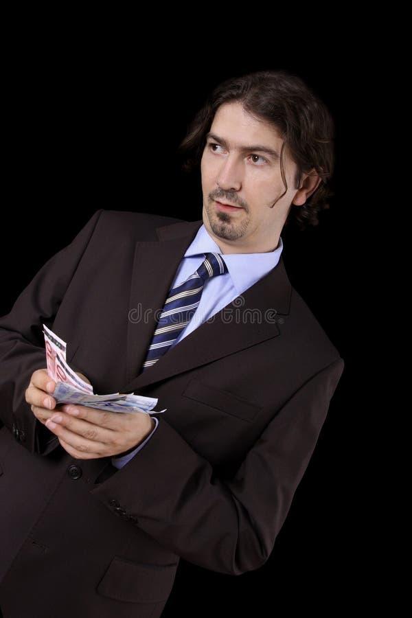 Het hoogtepunt van de zakenman van geld stock afbeelding