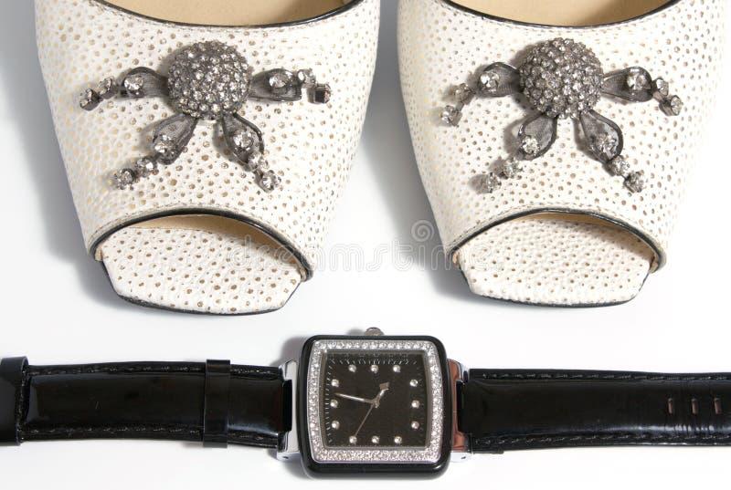 Het horloge van dames en hoge hielenschoenen royalty-vrije stock foto