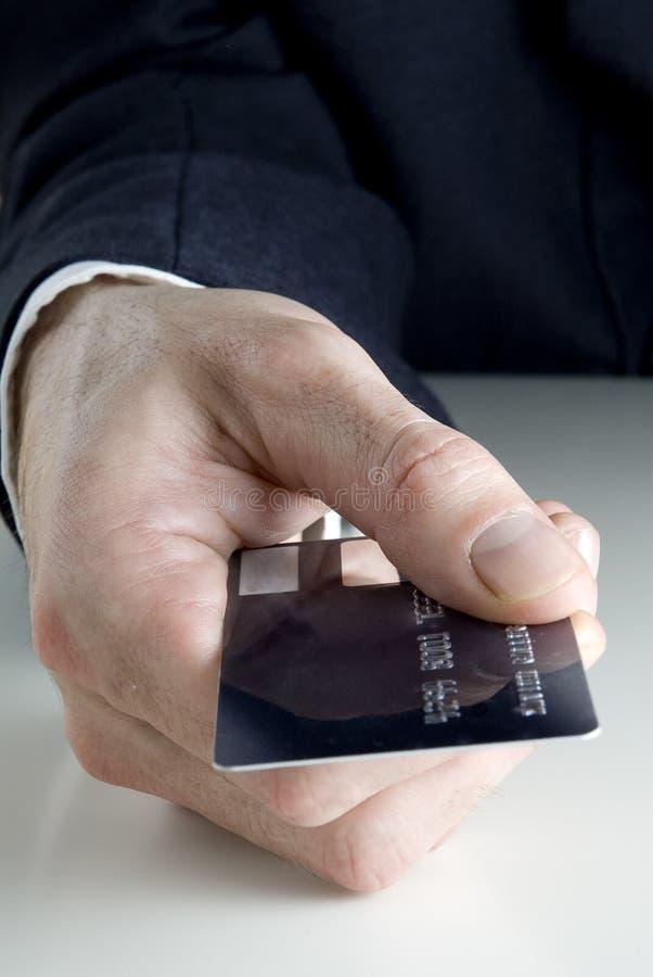 Het houden van een creditcard stock afbeeldingen